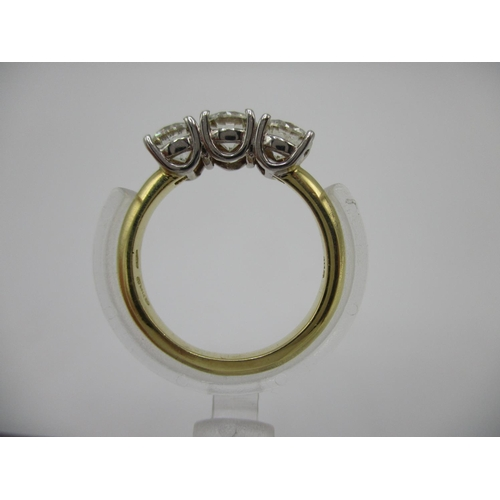 221 - An 18ct gold three stone diamond ring approximately 1.50ct, total size L/M, 4.2g...
