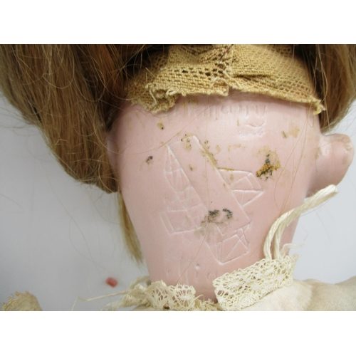 222 - A Mignon Felix Arena German bisque headed doll with biplane logo, closing eyes, open mouth and joint...