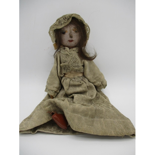 225 - A 19th century Grodnertal style peg doll with a pink painted face, a glass eye, (one missing) and lo...