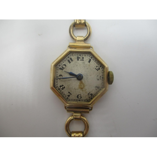 23 - An early 20th century Rolex 9ct gold ladies wristwatch having an octagonal case with Arabic numerals...