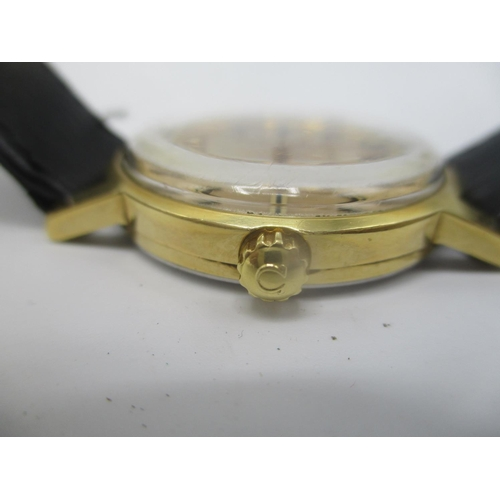 27 - An Omega gold plated gents manual wind wristwatch having a gilt dial with central seconds, on a late...