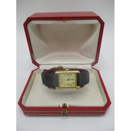 30 - A Must de Cartier, silver gilt manual wind ladies watch having sapphire inset crown, the case back i...
