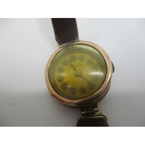37 - An early 20th century Rolex manual wind 9ct gold ladies wristwatch having a gilt dial, the case back...