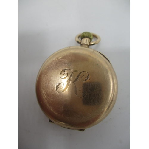 38 - An early 20th century 12ct gold keyless wound fob watch, having a white enamel dial with Roman numer...