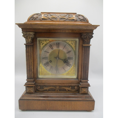 41 - A late 19th/early 20th century oak cased mantle clock, having a carved case with a gilt dial, silver...