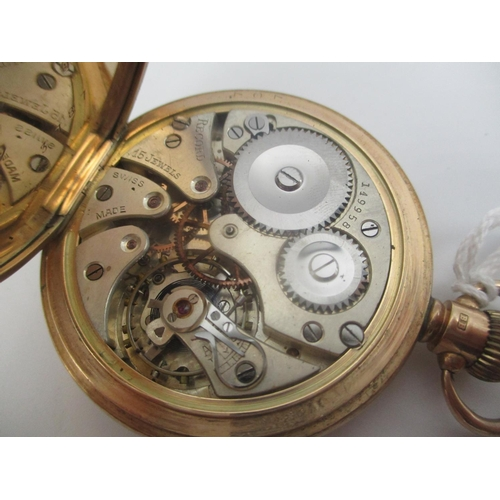 5 - An early 20th century Record Dreadnought, 9ct gold open faced pocket watch having a white enamel dia...
