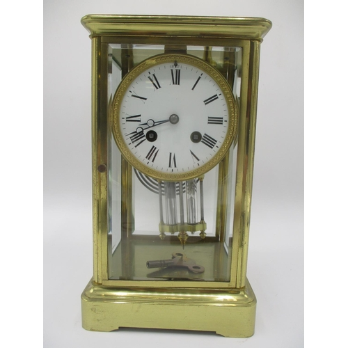 6 - A late 19th century French 8 day brass mantle clock having a mercury pendulum, the movement signed A...
