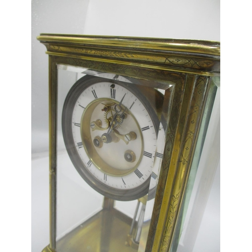 7 - A late 19th century French Samuel Marti 8 day brass mantle clock. The case having engraved decoratio...