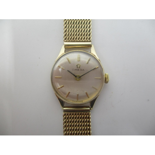9 - An Omega ladies 9ct gold manual wind wristwatch having a silvered dial with baton markers, the calib...