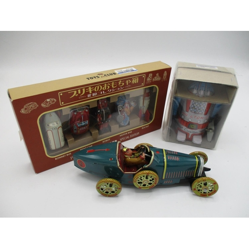 103 - A Japanese boxed wind up Action Mr Atomic tin toy robot by Cragstan, limited edition, 4
