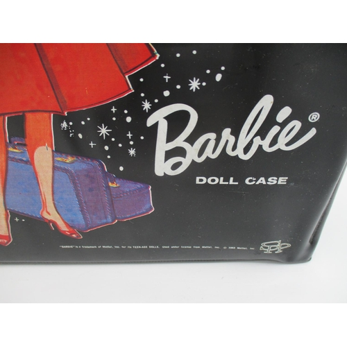 105 - A 1963 Barbie Doll together with a black patent travel wardrobe with assorted costumes and accessori...