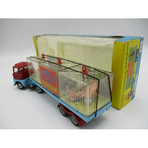 108 - Corgi No. 1139 Major Chipperfields Circus Seammell Handyman Menagerie in red and blue with cast hubs...