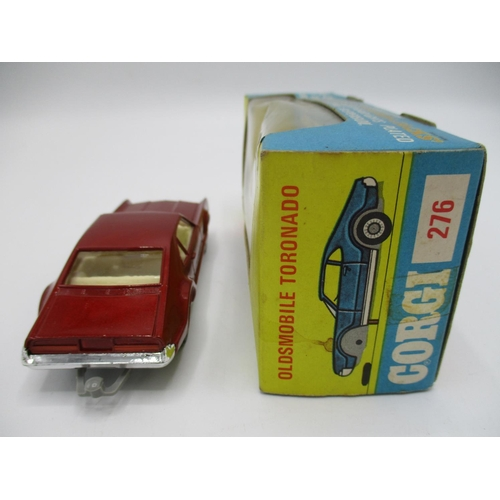 109 - Corgi No. 276 Olds Mobile Tornado metallic red in original display box and leaflet...