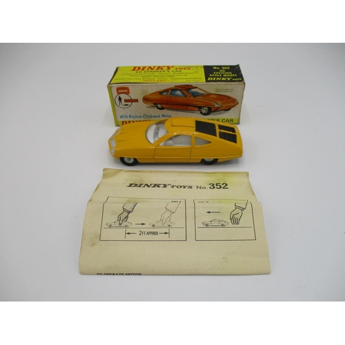 114 - Dinky yellow 352 UFO Ed Stakers car with instructions in original box...