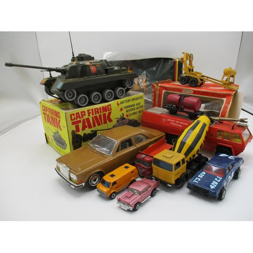 117 - A mixed lot to include Corgi Hyster Challenger 800 Marx Toys cap firing tank, battery operated, Brit...