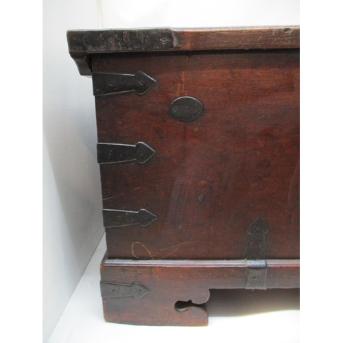 230 - An 18th century continental walnut chest with iron corners, strapwork and handles, having a hinged t...