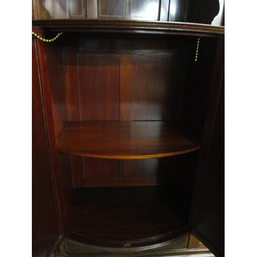 231 - An Edwardian Taylor and Hobson mahogany and extensive marquetry inlaid display cabinet with a centra...