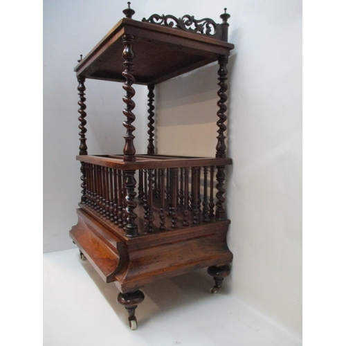 233 - A Victorian walnut Canterbury having a fretworked gallery, over barleytwist columns and three divisi...