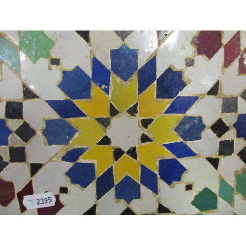 237 - A 20th century Moroccan fountain tiled in a floral mosaic design in red, blue, green, yellow and mot...