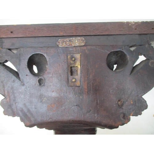 247 - A late 19th century continental carved lime wood wall bracket with later additional top, over a cher...