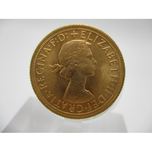 248 - An Elizabeth II gold full sovereign with St. George to the obverse, 1964...
