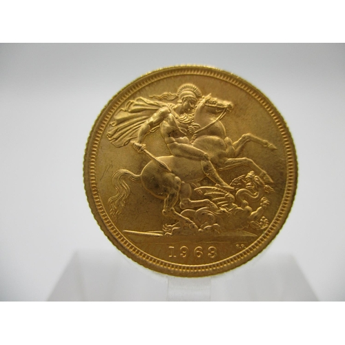 253 - An Elizabeth II gold full sovereign with St. George to the obverse, 1963...
