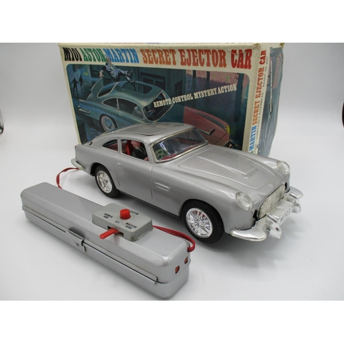 93 - A 1960s unite Japanese M101 James Bond Aston Martin secret ejector car with original Bond Villain fi...
