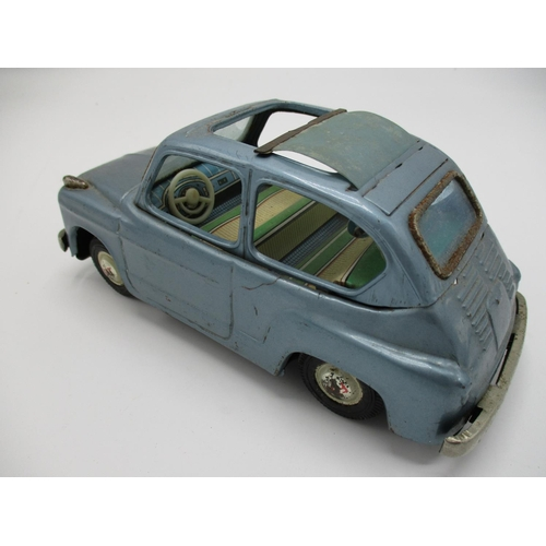 98 - A 1950s Bandai Japanese tin plate Fiat 600 with blue body and retractable sun-roof, Fraction Drive, ...