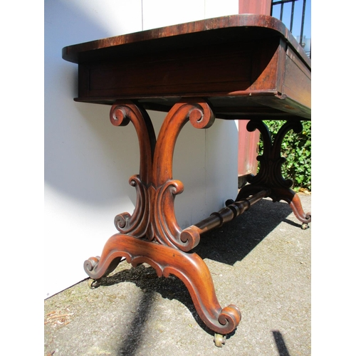 236 - A Regency rosewood sofa table with a pair of frieze drawers, over carved, scrolled ends, on splayed ...