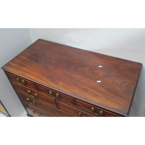 227 - A George III mahogany chest of three short in line drawers, over two short and one long drawer, on b...