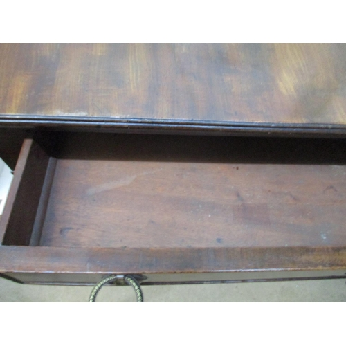 235 - A Regency mahogany sofa table with twin fall flaps, over two in line drawers with facsimiles to the ...