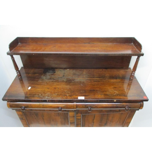 239 - An early 19th century rosewood chiffonier, the upstand with a shelf, over two cushioned drawers and ...