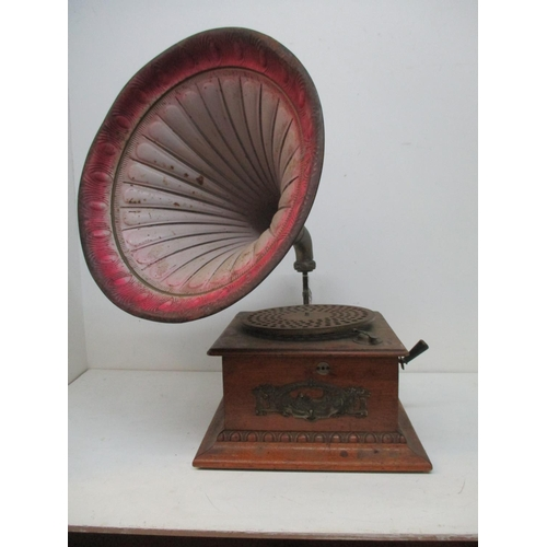 255 - An oak cased table top gramophone with a Collaro B28 motor, a metal plaque to the front with a woman...