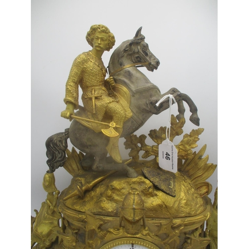 46 - A late 19th century French gilt metal mantle clock decorated with a man on horseback, armour and wea...