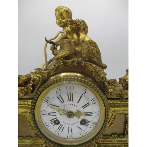 47 - A mid/late 19th century French gilt metal mantle clock decorated with a cherub to the top with two b...