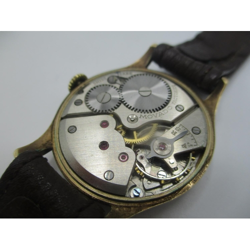 49 - A Movado manual wind 9ct gold gents wristwatch, the silvered dial having Arabic numerals and subsidi...