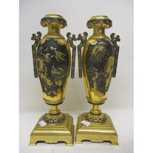 11 - A 19th century French, gilt metal mantle clock and garniture set.  The clock in the form of a Chines...