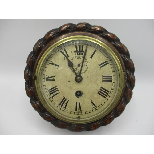 54 - An early 20th century ships clock in an oak rope twist case, the dial having Roman numerals and a su...