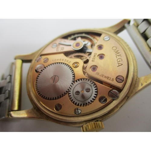 60 - An Omega 9ct gold gents manual wind wristwatch circa 1944, the dial having Arabic numerals and subsi...
