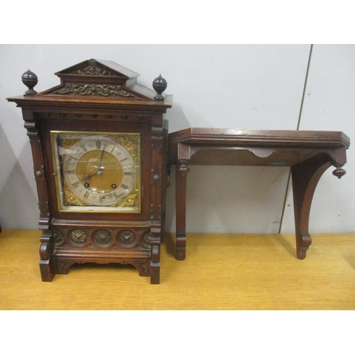 62 - A late 19th/early 20th century German bracket clock with wall bracket. The walnut case having gilt m...