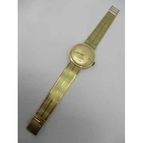 63 - A Bucherer automatic 18ct gold gents wristwatch circa 1960, having a gilt dial with centre seconds a...
