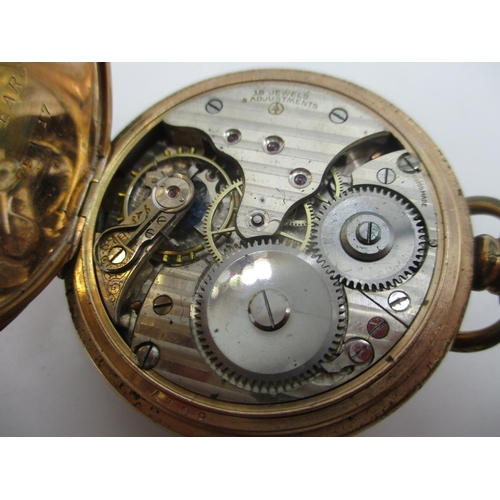 64 - An early 20th century half hunter gold plated, keyless wind pocket watch having a white enamel dial ...
