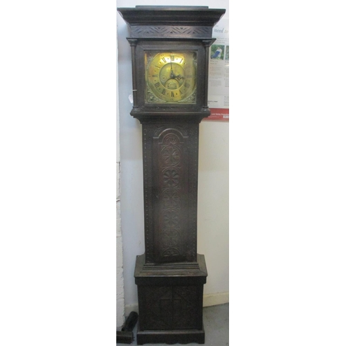 67 - An early 18th century and later longcase clock in a carved oak case. The brass dial having date chap...