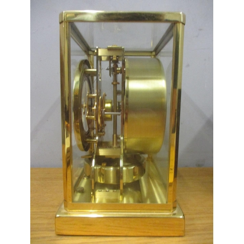 69 - A Jaeger Le Coultre Atmos clock circa 1960, in a gilt brass case, the cream chapter ring with baton ...