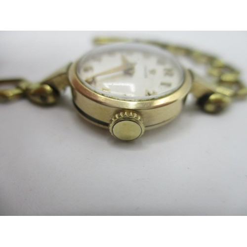 57 - An Omega manual wind, gold plated ladies wristwatch, circa 1956 having a white dial with Arabic nume...