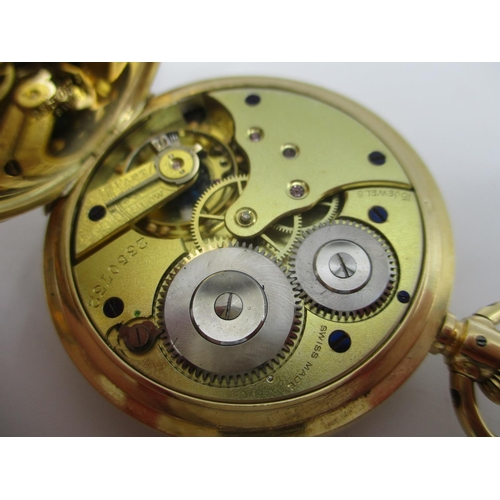 56 - An early 20th century 18ct gold full hunter, keyless wound pocket watch. The white enamel dial havin...