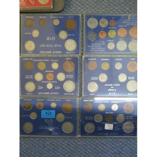 101 - A collection of coin sets, crowns, and commemorative crowns to include a Great Britain Year Type set...
