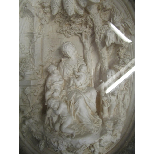 105 - Late Victorian/early 20th century cast plaster relief oval plaque, depicting a woman with four child...