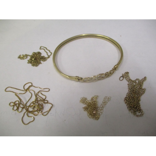 11 - Mixed yellow metal jewellery to include a bangle and four necklaces, 8.4 grams Location: CAB...