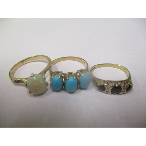 12 - Three 9ct gold rings to include a turquoise ring, opal ring and a sapphire and diamond ring, 6.9 gra...